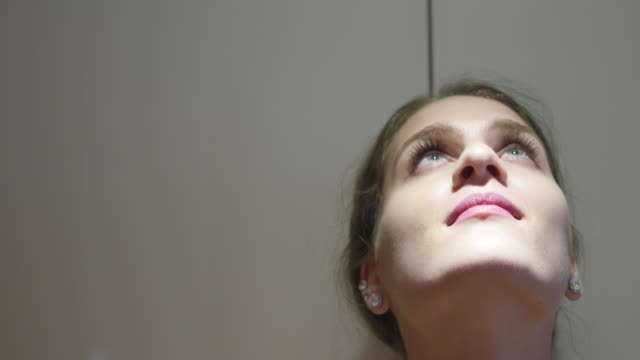 woman looking at the ceiling and then straight at the camera - pink lipstick stock videos and b-roll footage