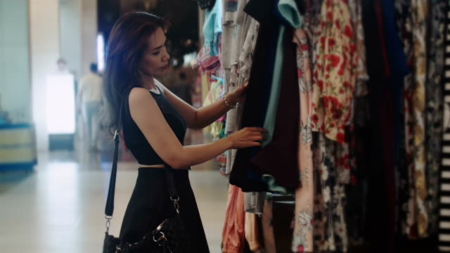 woman looking at the clothes in a boutique.