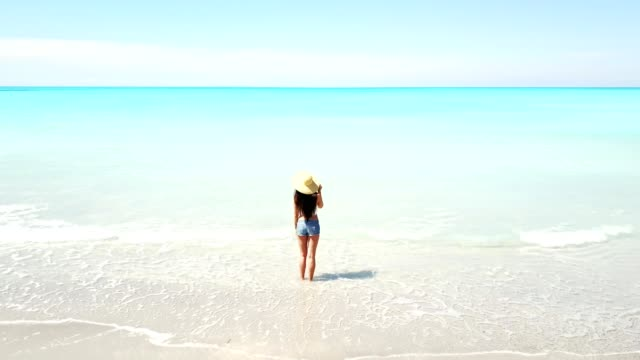 woman looking at the horizon - beach holiday stock videos & royalty-free footage