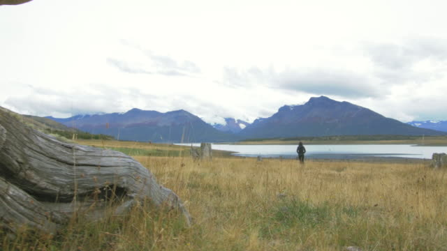 Woman looking at the lake in the Argentinian Patagonia