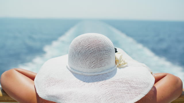 woman looking at the ship's wake - sun hat stock videos & royalty-free footage