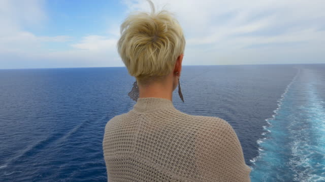 MS Woman looking at the ship's wake