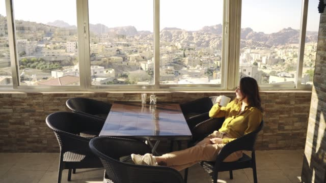 woman looking at wadi musa town from hotel - history stock videos & royalty-free footage