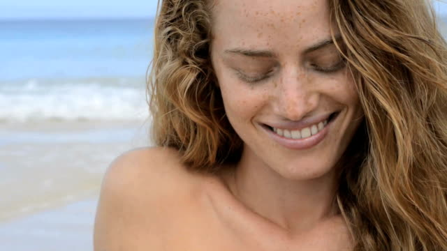 woman looking down and smiling - freckle stock videos & royalty-free footage
