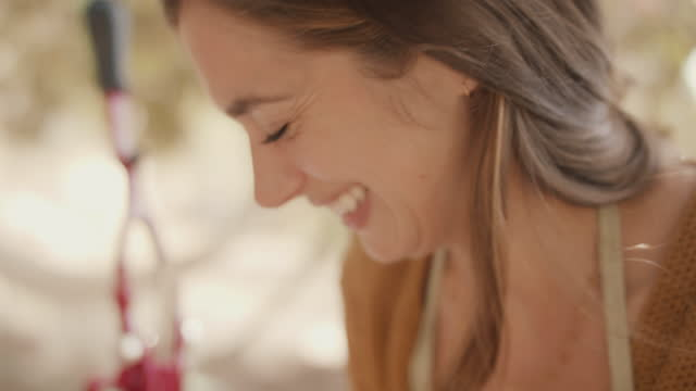 woman looking down smiling - long hair stock videos & royalty-free footage