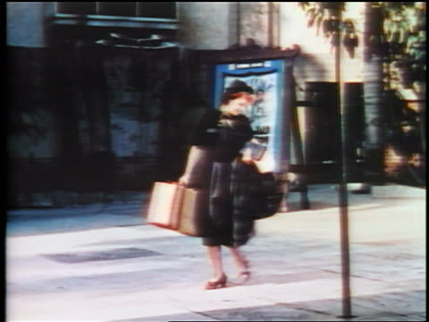 1937 woman looking down walking in front of grauman's theatre/ hollywood / feature - 1937 stock videos & royalty-free footage
