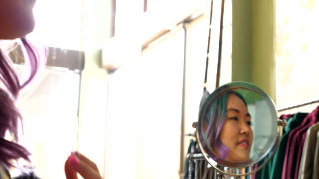 ms woman looking in mirror while trying on necklace in clothing boutique - choker stock videos & royalty-free footage