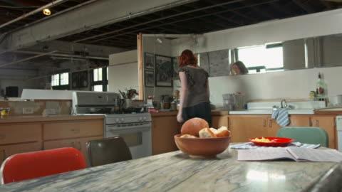 stockvideo's en b-roll-footage met hd: woman looking newspaper while having breakfast - werkloosheid