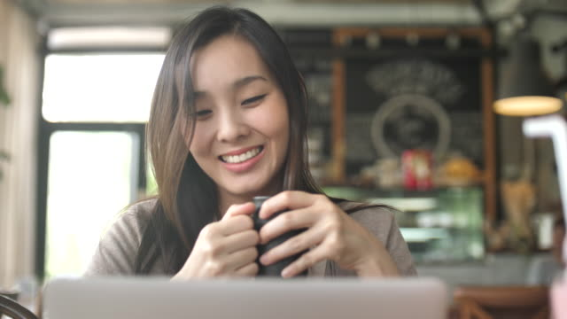 Woman Looking on Laptop