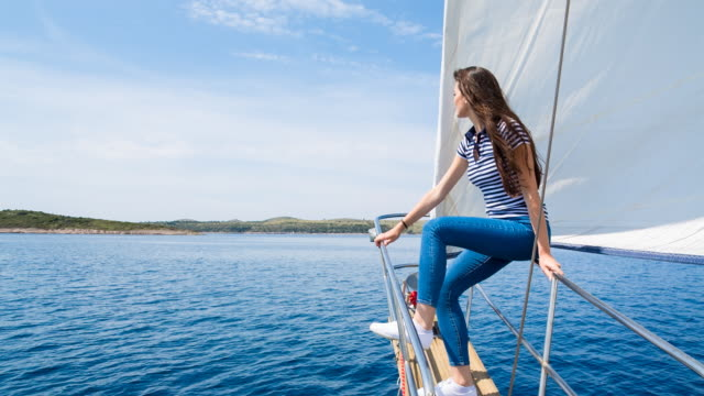 MS woman looking out over mediterranean sea on classic wooden sailing yacht