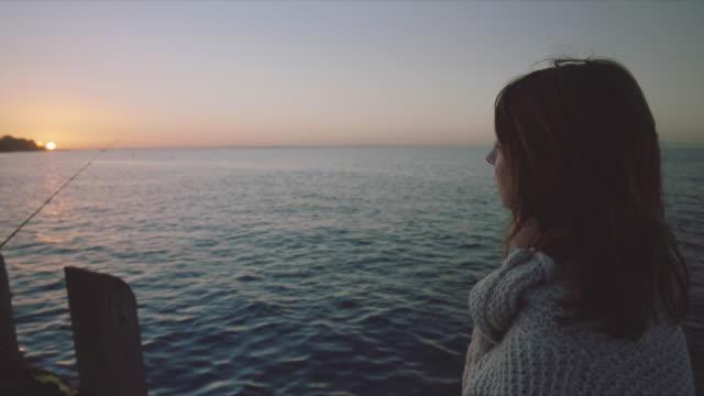 A woman looking the beautiful sunset, Mornington Peninsula, Victoria, Australia