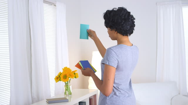 woman looking through paint chips