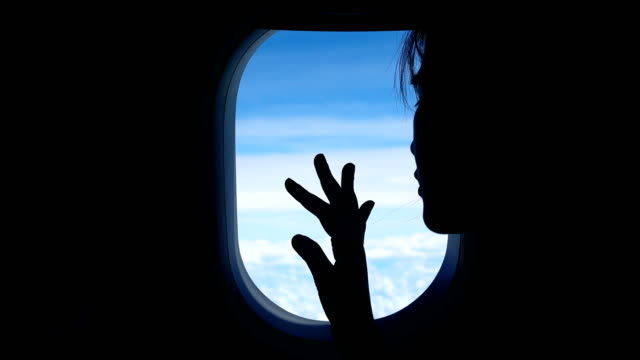 woman looking through the airplane window - looking through an object stock videos and b-roll footage