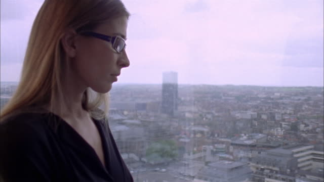 CU Woman looking through window / Brussels, Brabant, Belgium
