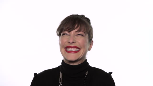 cu woman looking to camera laughing / london, uk - white background stock videos & royalty-free footage