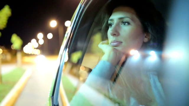 Woman looking trough the car glass