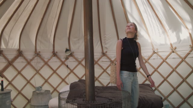 Woman looking up in yurt