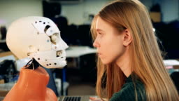 Woman looks at a robot's face. Human and robot.