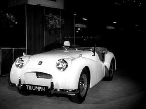 woman looks at a triumph sports car at the earls court motor show. - earls court stock videos & royalty-free footage