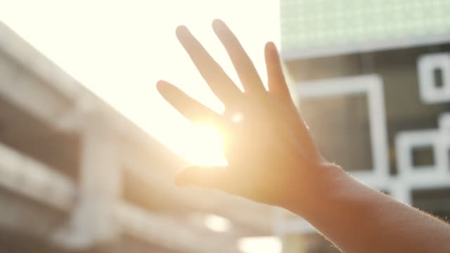 woman looks at the sun - bright stock videos & royalty-free footage