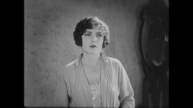 stockvideo's en b-roll-footage met 1922 woman (madge kennedy) looks disappointed - teleurstelling