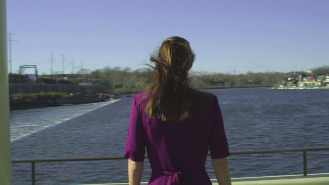 hd steadicam: woman looks out to the river - patio stock videos & royalty-free footage