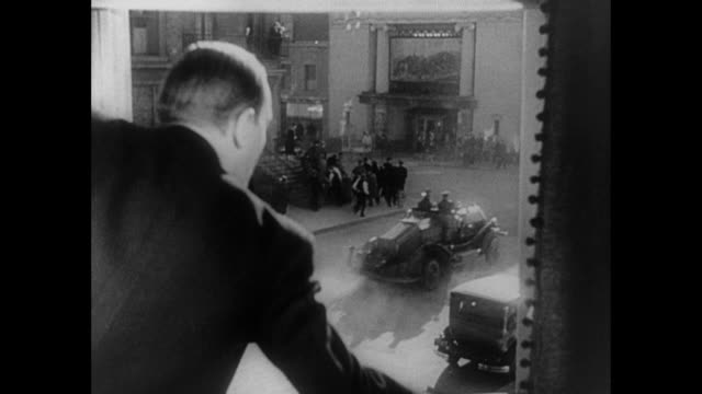 1931 Woman (Mary Brian) looks out window to busy street filling with emergency vehicles