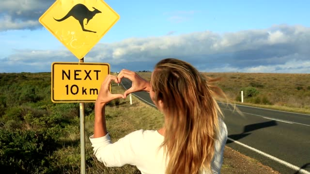 woman love road trip in australia - road warning sign stock videos & royalty-free footage
