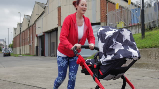 woman lunging outdoors with baby in carriage - carriage stock videos & royalty-free footage