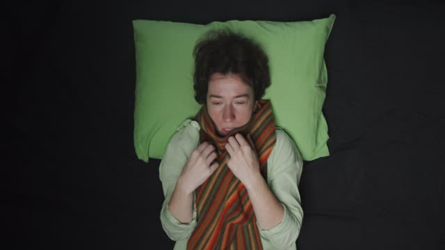 woman lying in bed with cold and flue symptoms - lying on back stock videos & royalty-free footage