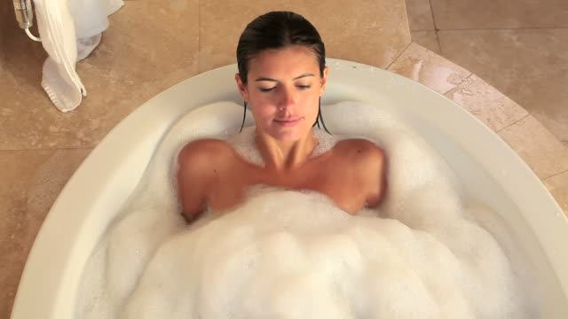 Woman lying in her bath