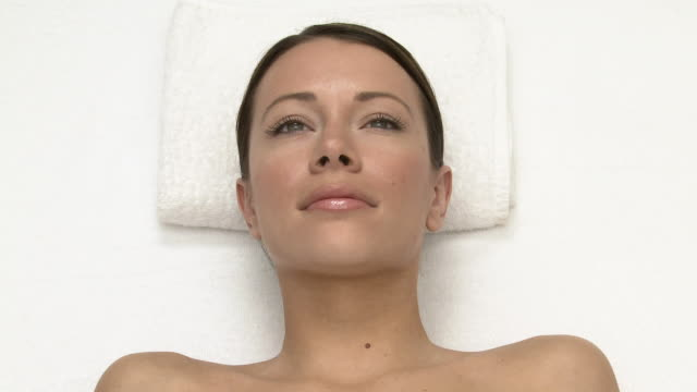 woman lying on massage table - brown hair stock videos & royalty-free footage