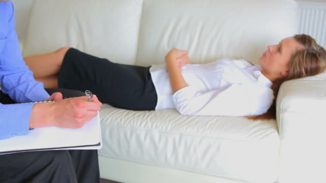 Woman lying on the sofa at a therapist