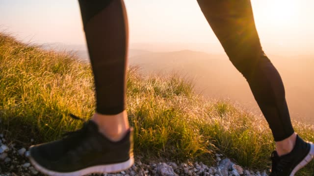 woman maintaining a healthy lifestyle, running in the mountains - uphill stock videos & royalty-free footage