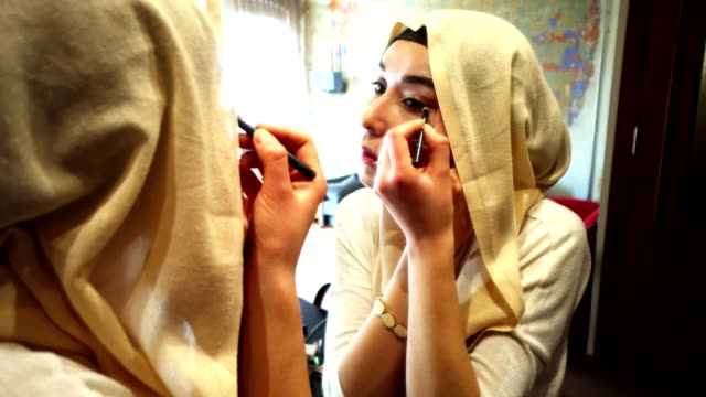 woman make up in front of the mirror - turban stock videos & royalty-free footage