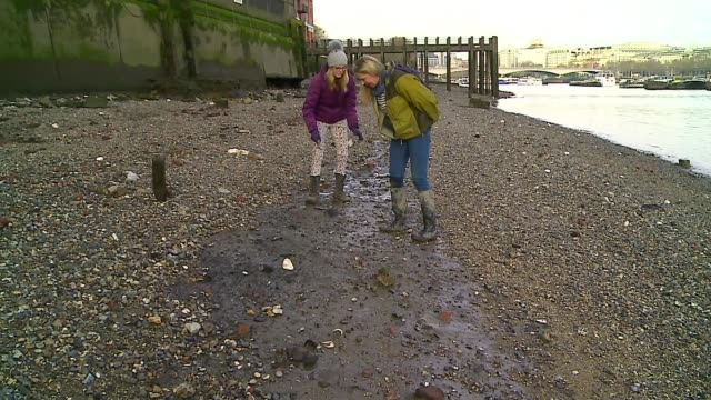 Woman makes art from objects found while mudlarking UK London Nicola White interview London EXT Nicola White interview as mudlarking with reporter...