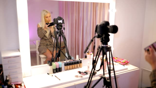 woman make-up artist filming tutorial in make-up studio - stage make up stock videos and b-roll footage