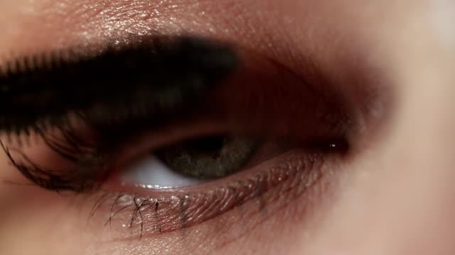 woman makeup closeup - extreme close up stock videos & royalty-free footage