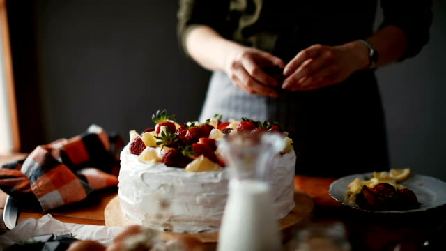 woman making a cake at home - caterer stock videos and b-roll footage