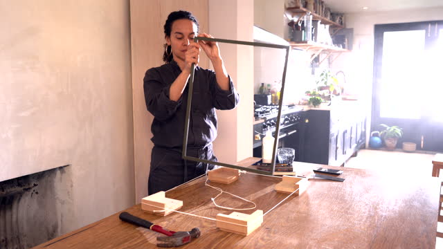 woman making a frame at home - ponytail stock videos & royalty-free footage