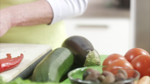 woman making a salad, sweden. - only mature women stock videos & royalty-free footage