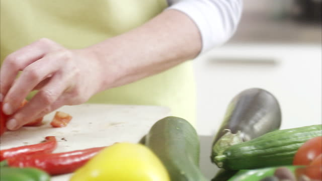 woman making a salad, sweden. - one mature woman only stock videos & royalty-free footage