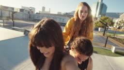 Woman making a selfie with friends on bike
