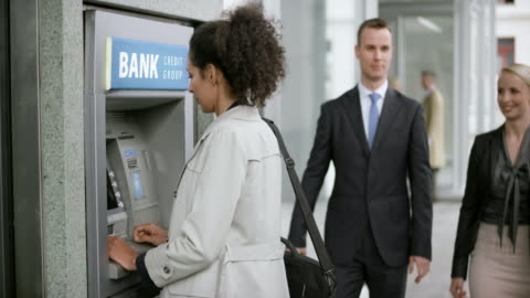 vídeos de stock e filmes b-roll de woman making a withdrawal from the atm machine - making money