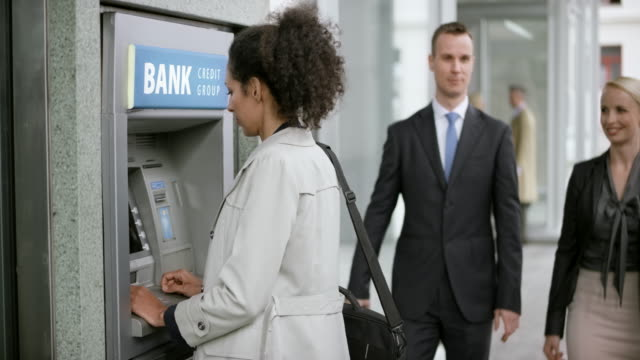 Woman making a withdrawal from the ATM machine
