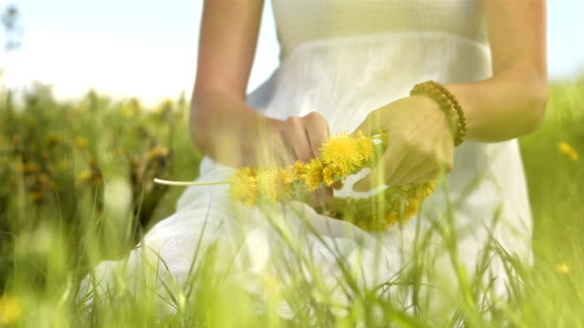 hd slow motion: woman making a wreath of wildflowers - wreath stock videos & royalty-free footage