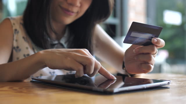 Woman making an online credit card purchase on Tablet PC