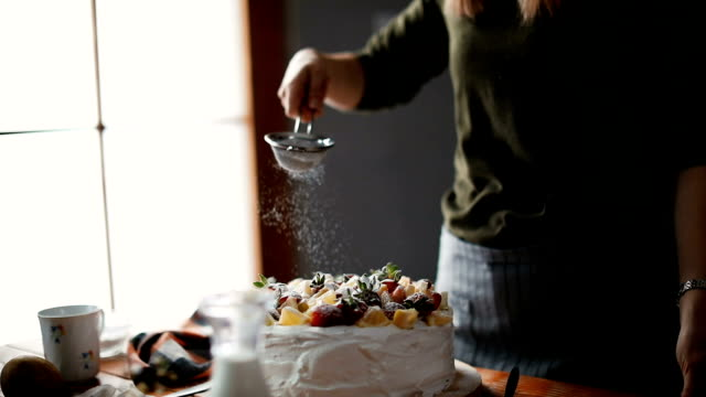 woman making birthday cake - making a cake stock videos and b-roll footage