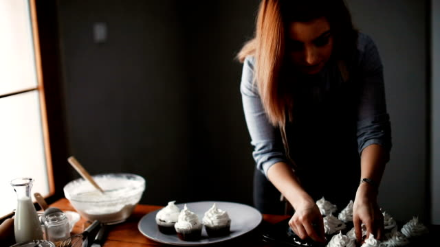 woman making cupcakes in kitchen - icing stock videos and b-roll footage