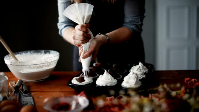 Woman making cupcakes in kitchen